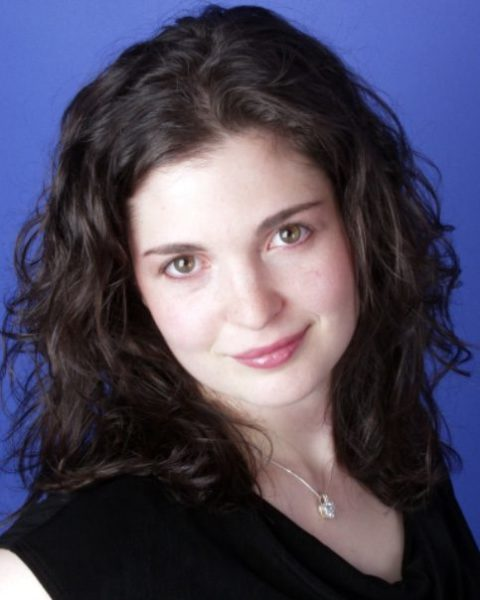 Athena Mertes, Soprano, against a blue background.