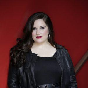 Alexandra Loutsion, posing in dark clothing.