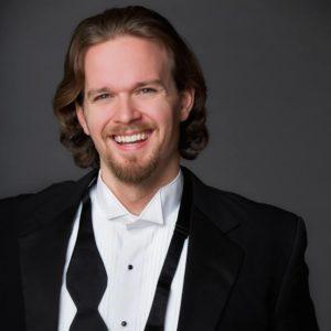 Gabriel Preisser, smiling in a tux with an untied bowtie hanging around his neck.